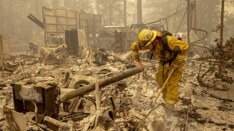 A firefighter examines wreckage in Berry Creek, California. Photo: 12 September 2020