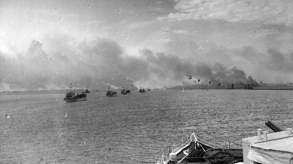 British helicopters flying over landing craft approaching Port Said during the Suez Crisis