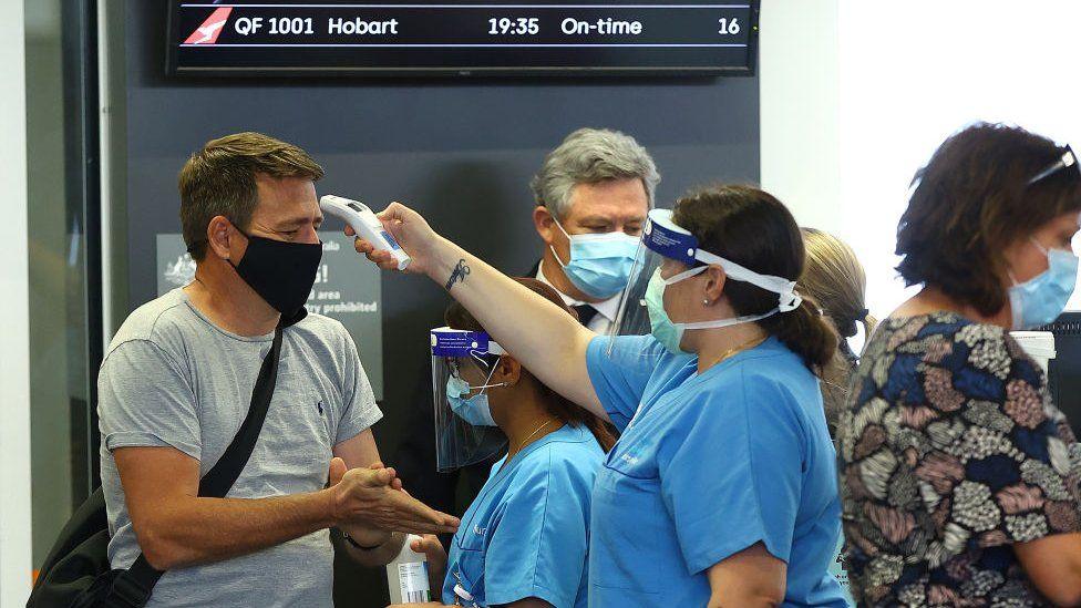Passengers are temperature checked