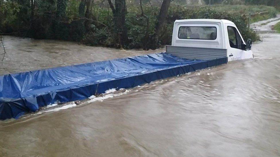 A van in flood water