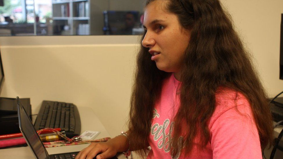 Maysie Gonzales using the internet on her laptop