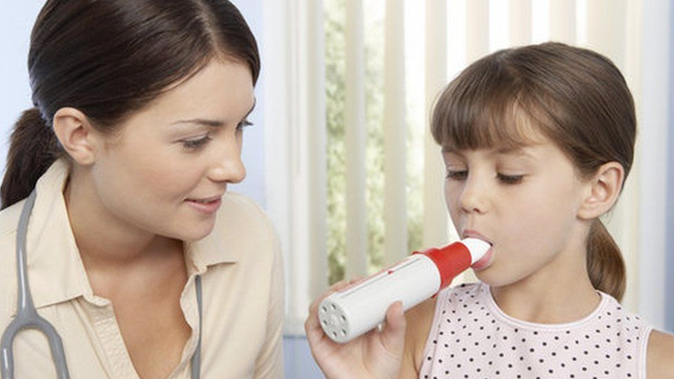 Doctor and a girl with asthma