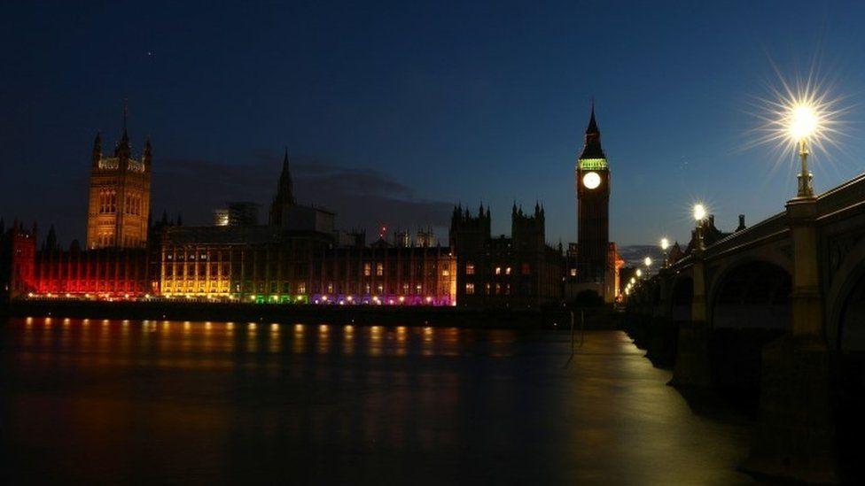 The Houses of Parliament are illuminated to mark the Pride in London Parade in London, Britain July 8, 2017.