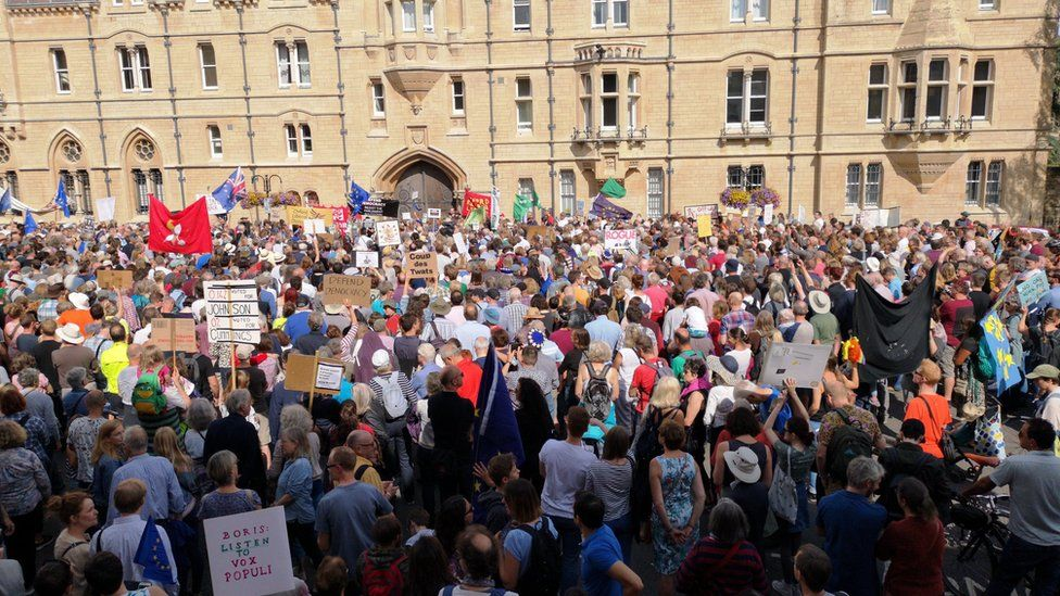 In Oxford, protesters gathered outside Mr Johnson's former Balliol College