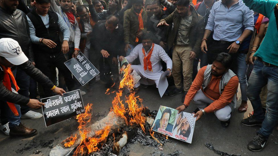 Right wing Hindus burn photos of Mr Azhar and Pakistani Prime Minister Imran Khan