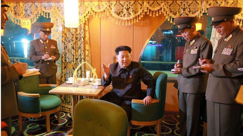 This undated picture released from North Korea's official Korean Central News Agency shows North Korean leader Kim Jong-Un giving out advice during an inspection of the newly-built excursion boat Mujigae