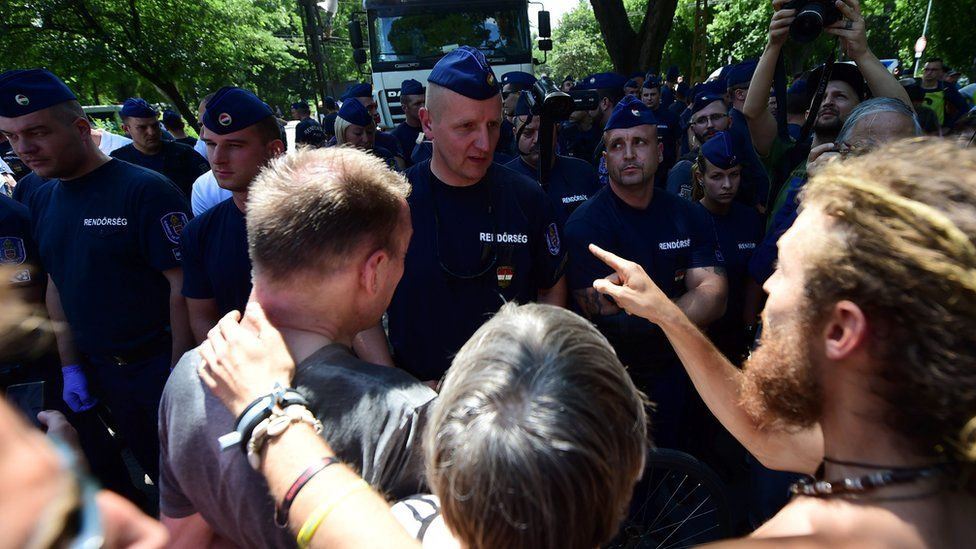 Activists talk to police in Budapest central park
