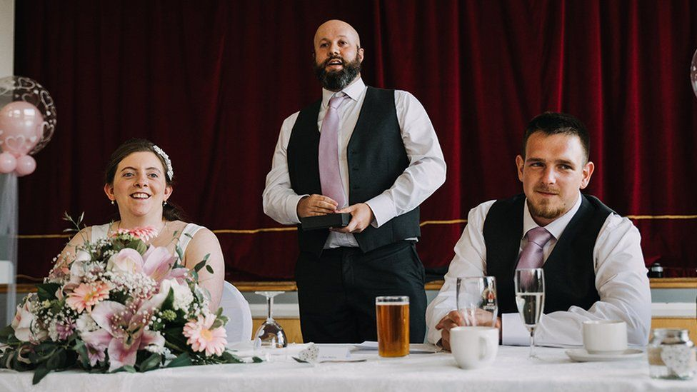 A bride, best man and groom at a wedding