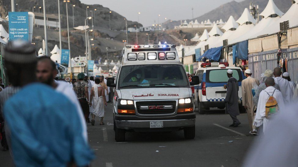An ambulance rushes to the site where pilgrims were crushed and trampled to death during the annual Hajj pilgrimage in Mina, Saudi Arabia, Thursday, 24 September 2015.