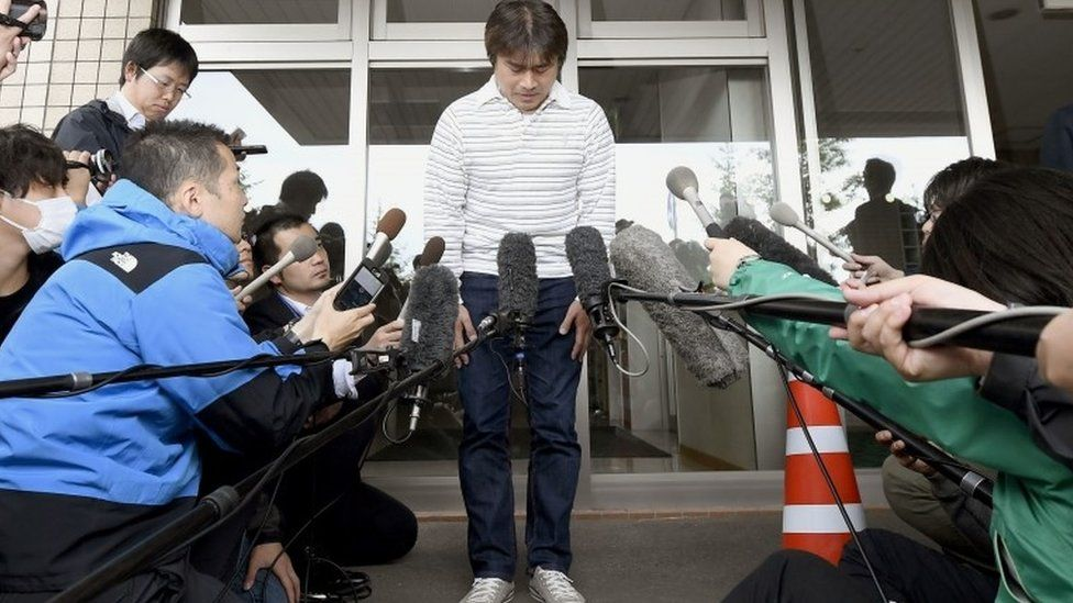 Takayuki Tanooka, father of the 7-year-old Japanese boy who went missing nearly a week ago, bows in front of media after his son was found, in Hakodate, Hokkaido Friday, June 3, 2016.
