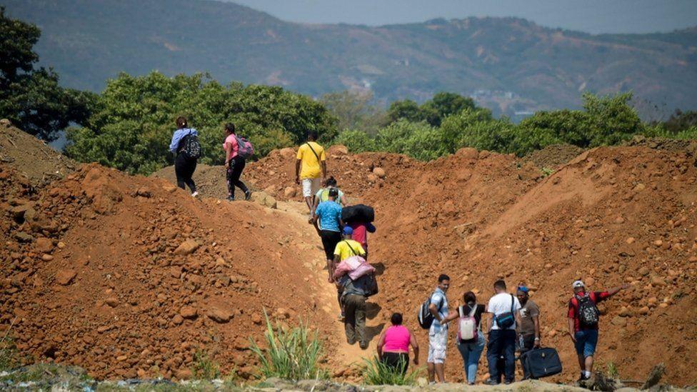 "People cross from Venezuela through ""trochas"" - illegal trails- near the Simon Bolivar International Bridge"
