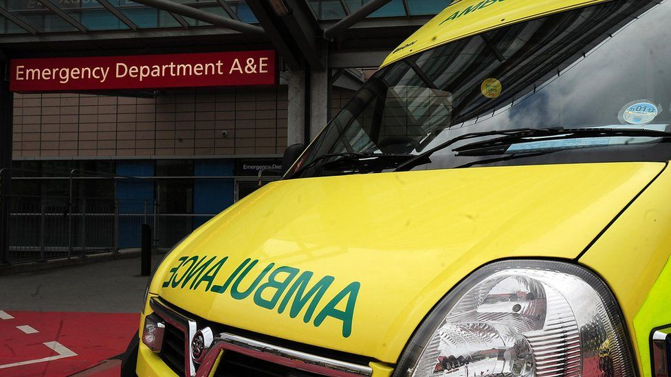 NHS ambulance outside Accident and Emergency entrance