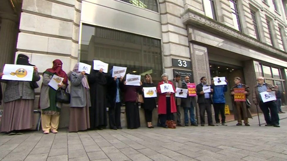 Demonstrators outside the High Court in Birmingham before the hearing