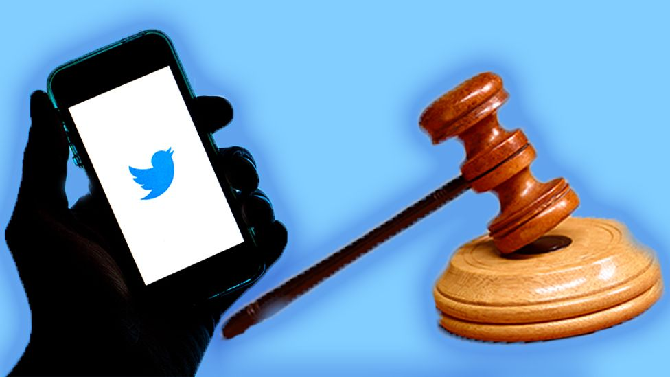 A phone with Twitter on it and a judge's mallet