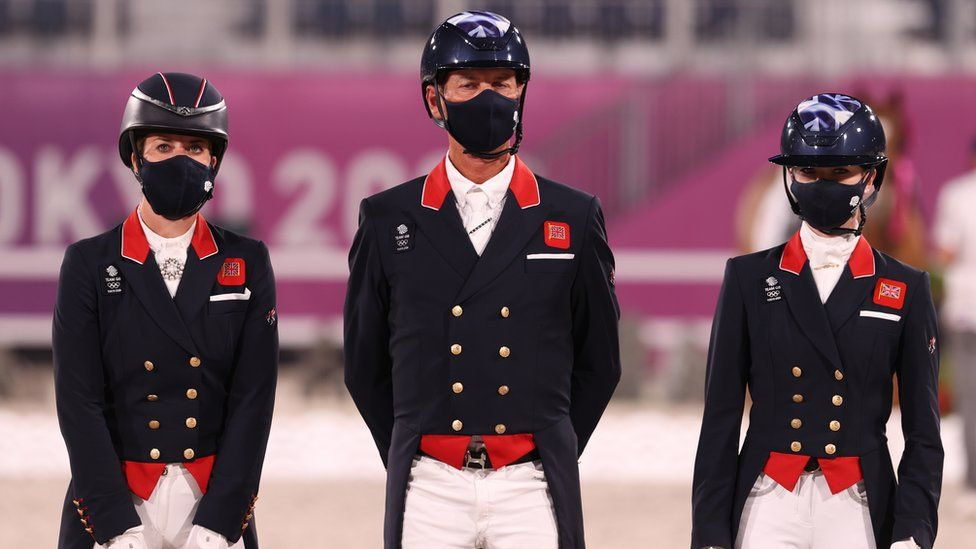Bronze medalist Charlotte Dujardin, Carl Hester and Charlotte Fry of Team Great Britain