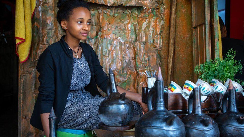 Ethiopian woman preparing coffee in a bar, Harari region, Harar, Ethiopia on August 8, 2019 in Harar, Ethiopia