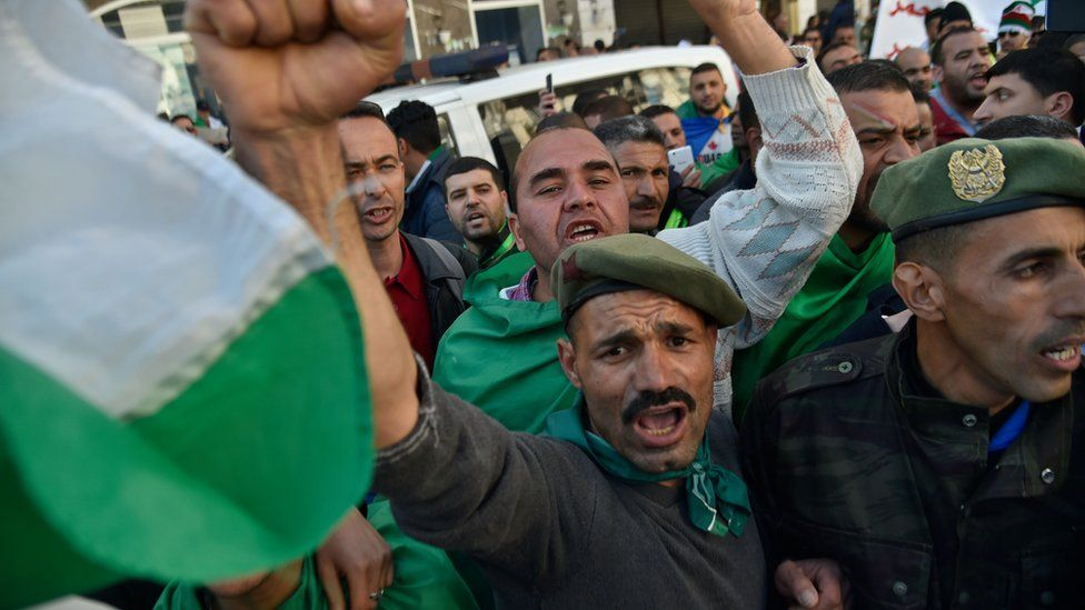 Veteran soldiers from Algeria's civil war take part in a demonstration against ailing Abdelaziz Bouteflika in the capital Algiers on 29 March 2019