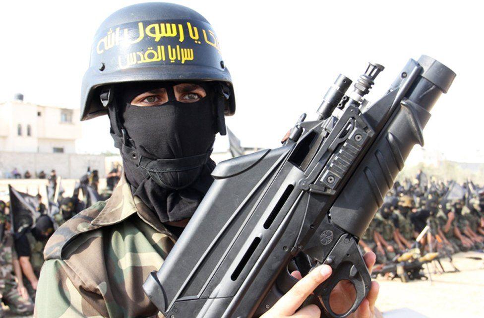Man holding gun in Gaza parade, 2012