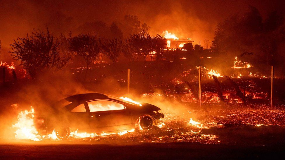 Vehicles and homes burn as the Camp fire tears through Paradise, California