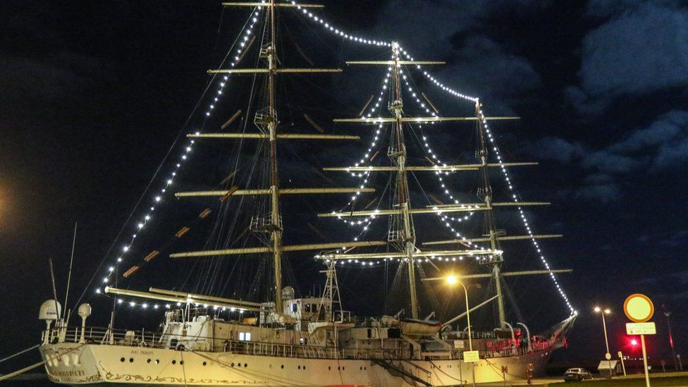 A ship with a Christmas tree made of LED lights on board the SV Dar Mlodziezy Poland