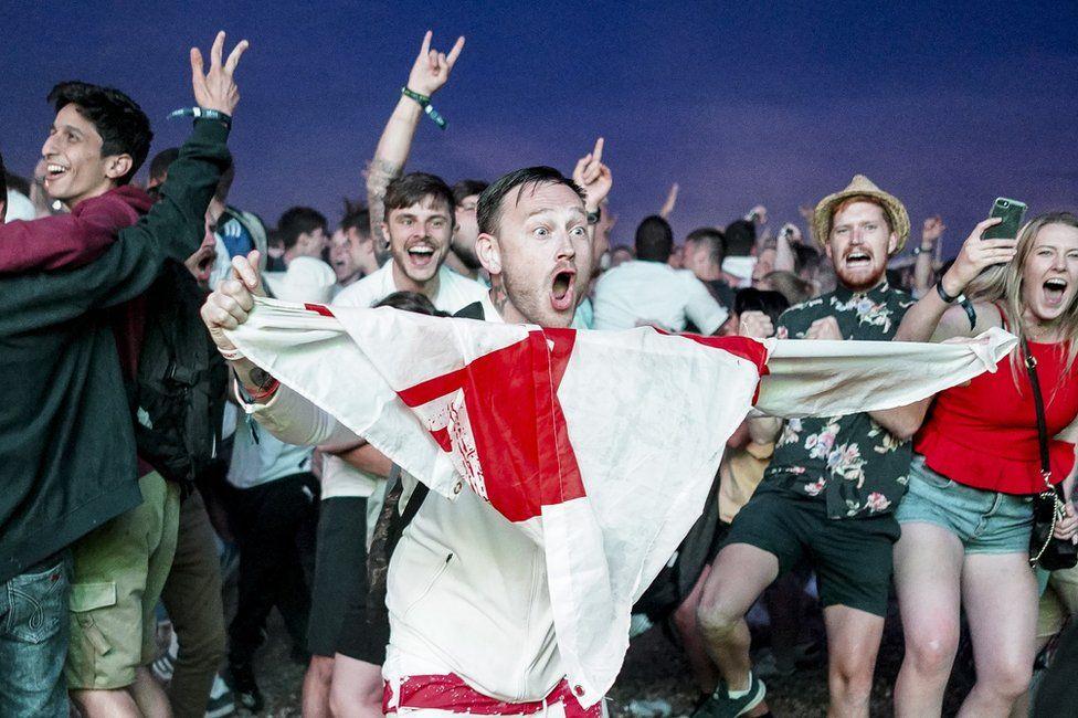 England fans celebrate on Brighton beach