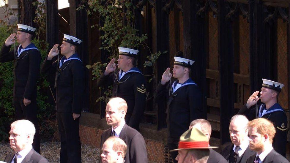 A Royal Navy Piping Party pipes the Still