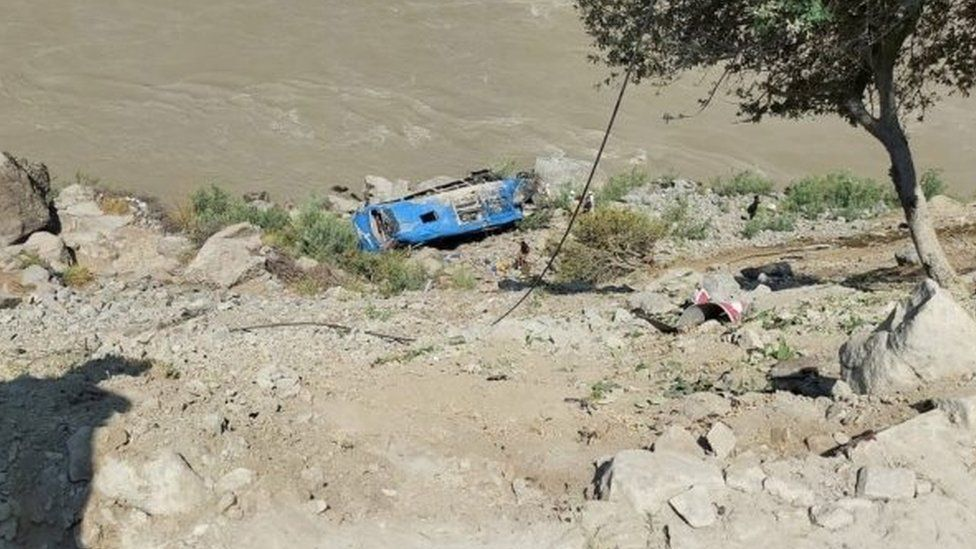 A handout photo shows wreckage of a bus that was carrying Chinese engineers to project site, after it fell into a ravine following a blast in Kohistan, Pakistan, 14 July 2021.