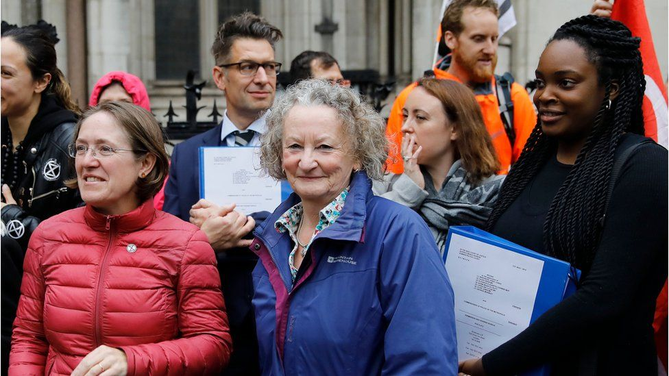 Green Party peer Jenny Jones and lawyers outside the High Court in London on October 24