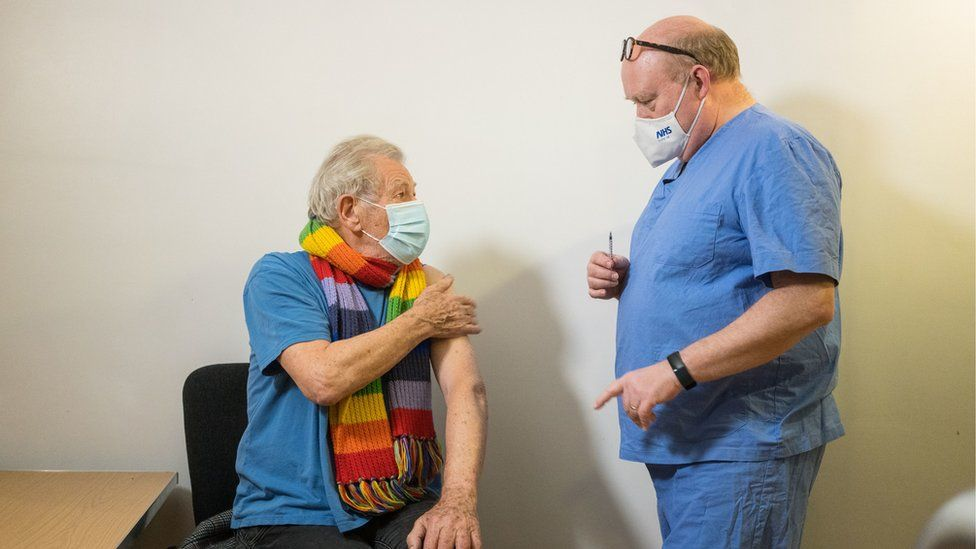 Sir Ian McKellen talking to a GP about the vaccine