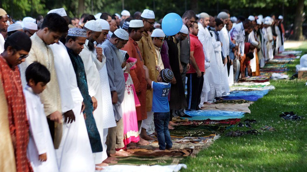 Muslim faithfuls take part in a special morning prayer to start their Eid al-Fitr celebrations on a field at the Prospect Park in Brooklyn borough of New York on July 17, 2015