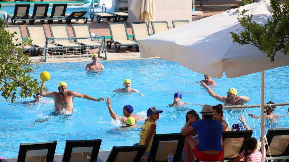 People play water polo in a Turkish hotel pool