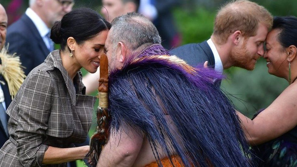 """Prince Harry and his wife Meghan, the Duchess of Sussex, receive a """"hongi"""", or traditional Maori greeting from elders"""
