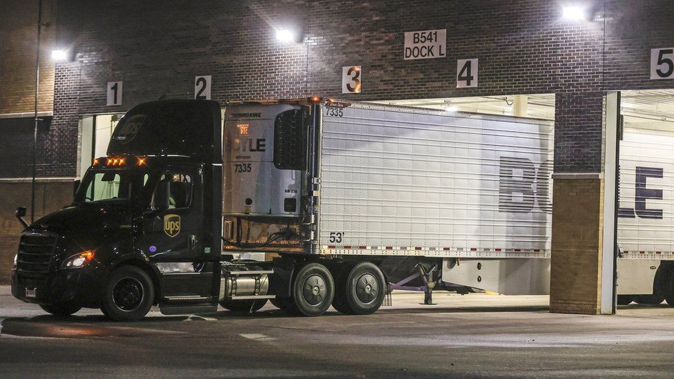 A truck is positioned at the loading dock of the Pfizer Inc., manufacturing and storage facility in Portage, Michigan, USA, 13 December 2020.