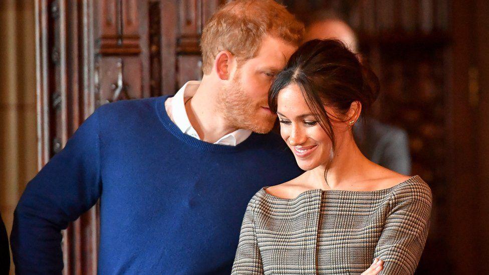 Meghan Markle, listening to husband Prince Harry
