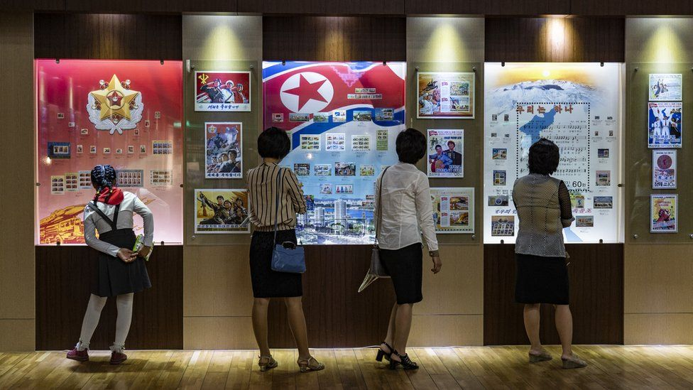 A young school girl (left), her mother (second from the left) and two women at the stamp museum in Pyongyang