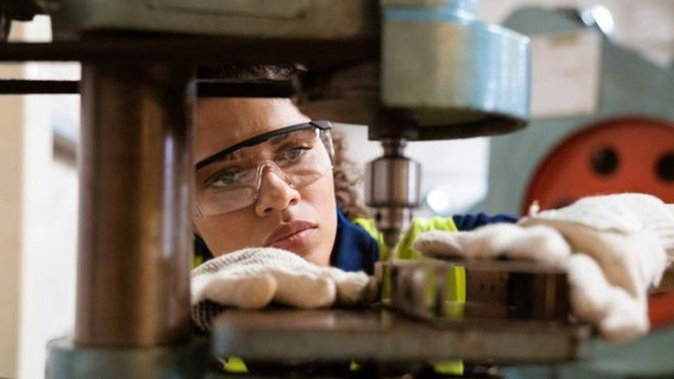 Woman at machinery