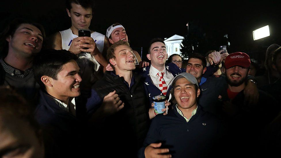 A group of Trump supporters sing in front of the White House after midnight on November 9, 2016 in Washington, DC.