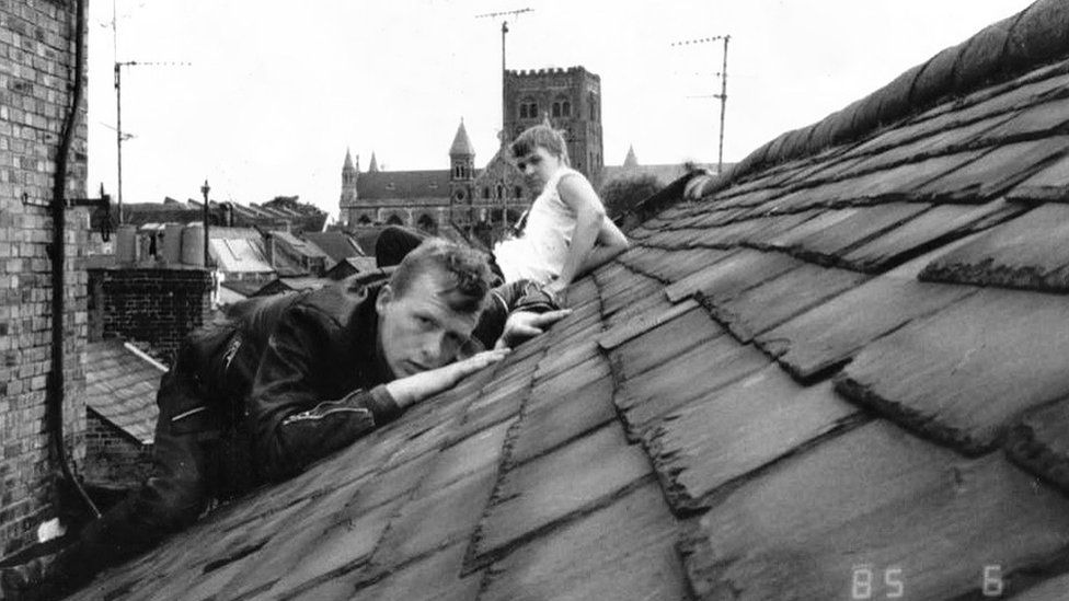 Sam Tharby and and Dave Kotula, 1985, Lower Dagnell Street roof checking out the cathedral