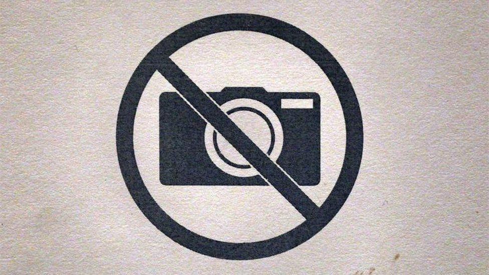 A no photography sign