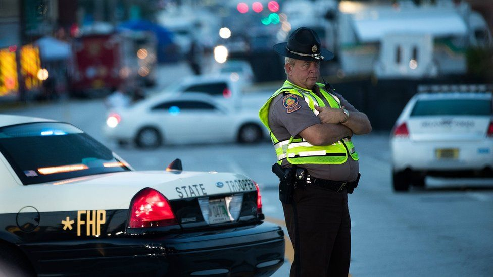 Police and law enforcement officials continued to block off parts of South Orange Avenue near Pulse Nightclub on Monday morning, June 13, 2016 in Orlando, Florida.