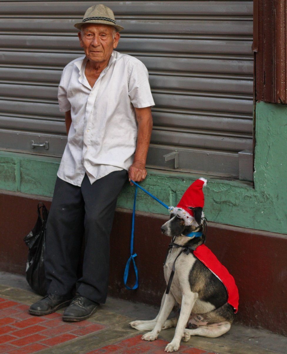 man and his dog in Peru
