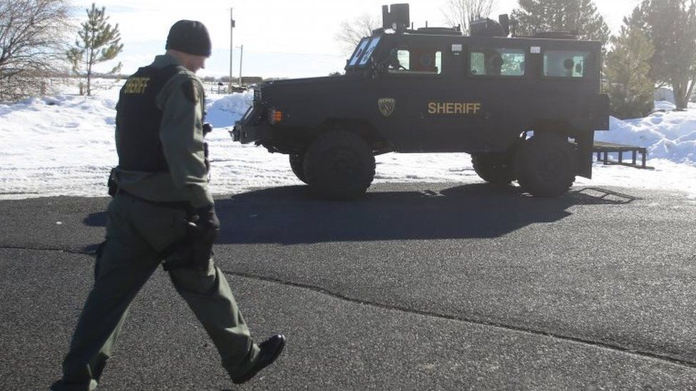 Members of the Deschutes County Sheriffs Department park an armoured vehicle in Burns, Oregon