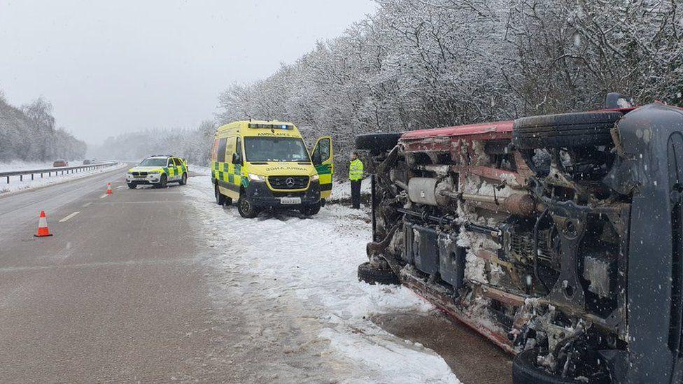 Overturned car on M54