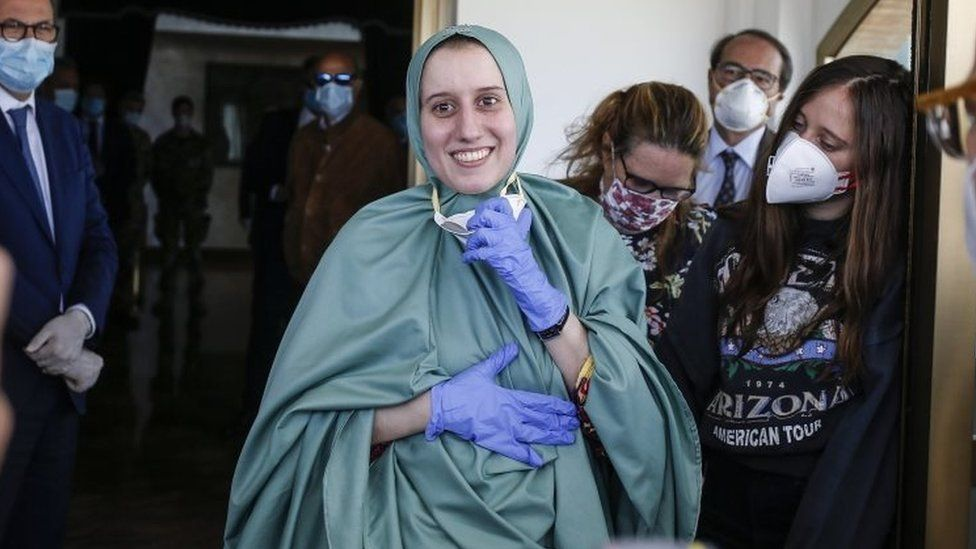 Silvia Romano (centre) smiles after arriving at Rome's airport, Italy. Photo: 10 May 2020