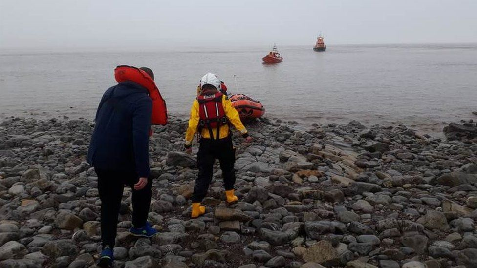 Three Russians being rescued