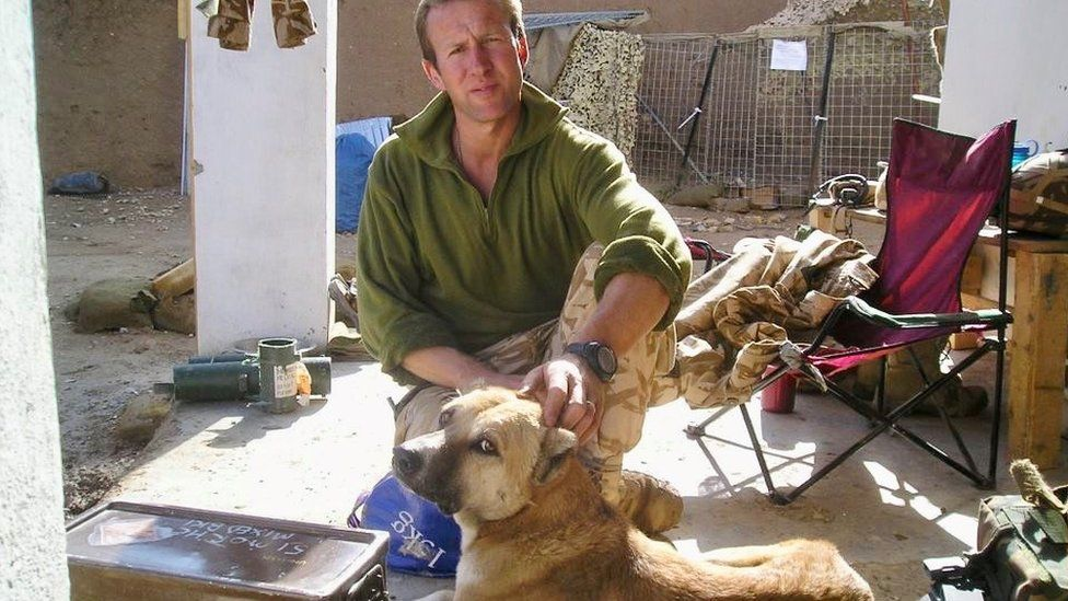 Pen Farthing with a rescue dog