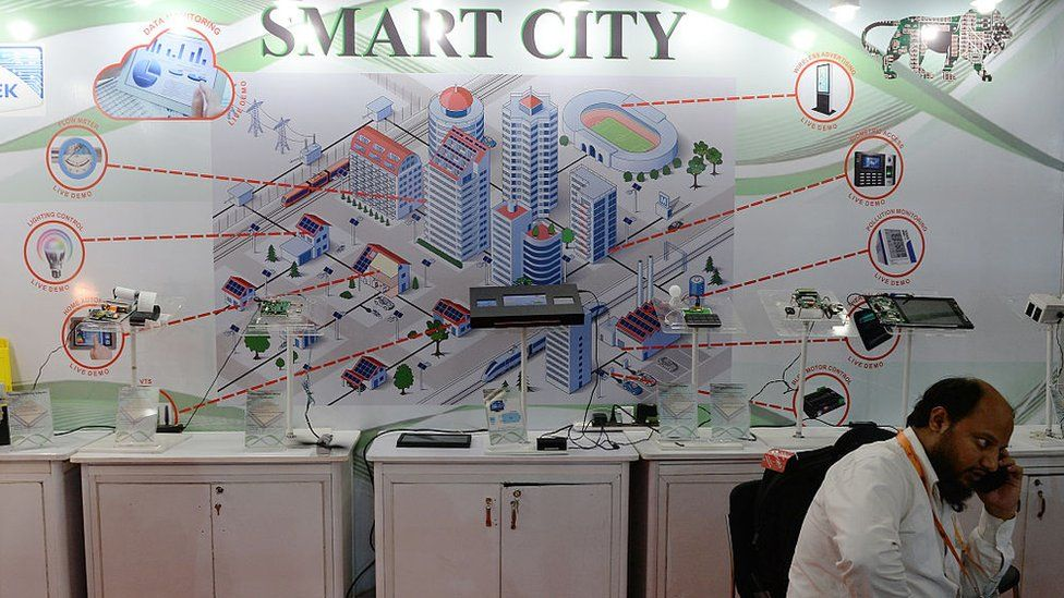 An Indian delegate talks on a phone during the Smart Cities India 2016 expo in New Delhi on May 12, 2016.
