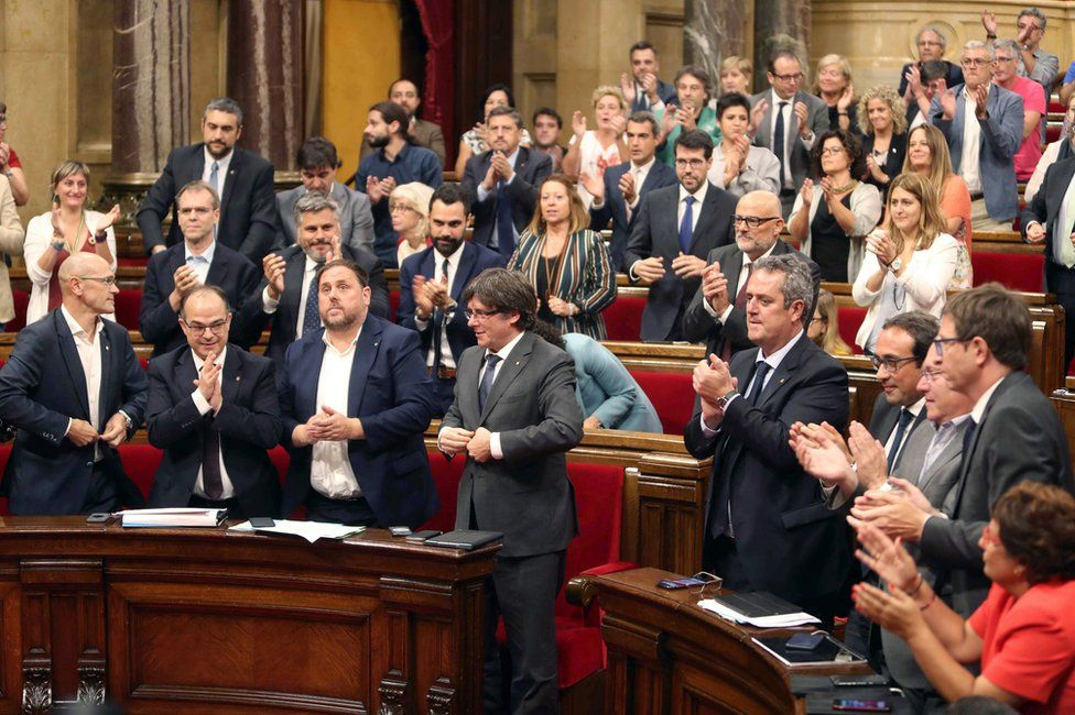 Catalan MPs celebrate the vote in parliament in Barcelona, 6 September