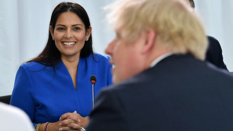 Priti Patel and Boris Johnson