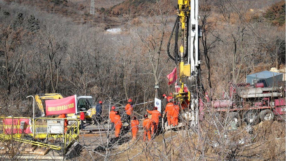 Members of a rescue team work at the site of a gold mine explosion where 22 miners are trapped underground in Qixia, in eastern China's Shandong province on January 18, 2021.